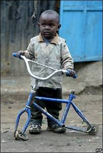 poor-child-bicycle-africa-slum_1